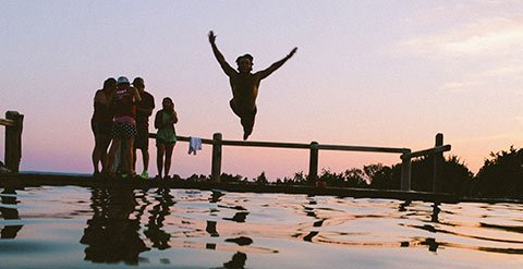 person-jumping-into-pool